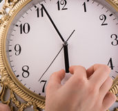 Isolated clock. Hand  in touch with a clock on a white background Royalty Free Stock Photography