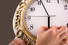 Isolated clock. Hand  in touch with a clock on a white background Stock Image