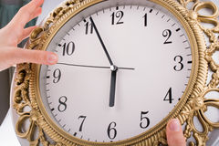 Isolated clock. Hand  in touch with a clock on a white background Royalty Free Stock Photos