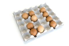 An isolated close-up of brown chicken eggs lay in a cardboard tray in the form of the number 21. Easter Concept stock photography