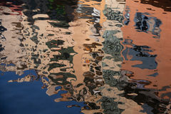 Isolated close-up of ripples on the surface of the river. reflection of building on ripples in river. Isolated close-up of ripples on surface of the river Royalty Free Stock Photography