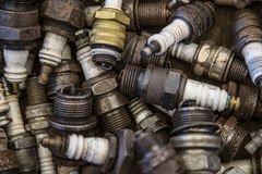Isolated Close View of a Collection of Old Used Spark plugs royalty free stock images