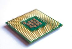 Isolated closeup microprocessor lying on white table stock photography