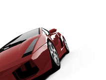 Isolated closeup sportcar view. Isolated closeup sport car on a white background Stock Images