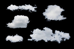 Isolated clouds. Set of isolated clouds over black. Design elements Royalty Free Stock Photo