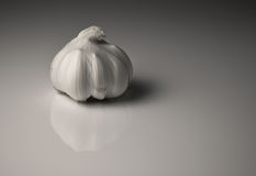 Isolated clove of garlic Stock Photography