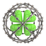 Isolated cloverleaf in barbed wire sphere Stock Images