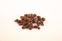 Isolated coffe beans. Isolated brown coffe beans, on white background Royalty Free Stock Image