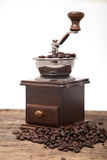 Isolated coffee bean grinder next to fresh coffe bean Stock Images