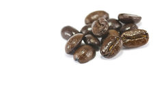 Isolated coffee beans. Dark Shiny Roasted Coffee Beans isolated on white Stock Images