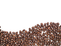 Isolated coffee beans arrange at the bottom in curve line shape. For background and texture royalty free stock photography