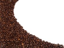 Isolated coffee beans arrange in curve line shape for background and texture. Copyspace. Isolated coffee beans arrange in curve line shape for background and royalty free stock photos