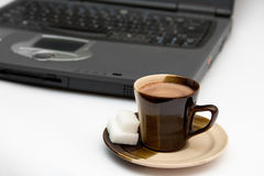 Isolated coffee and laptop.  Royalty Free Stock Photos
