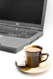 Isolated coffee and laptop.  royalty free stock image