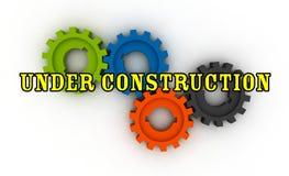 Isolated cogwheels - under construction royalty free stock image