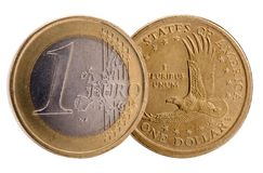 Isolated coins of Dollar and Euro currencies stock photos