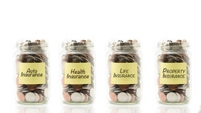 Isolated coins in jars Stock Images