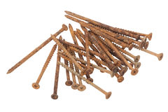 Isolated Collection of Long Rusty Screws with Flat Heads Royalty Free Stock Images
