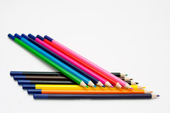 Isolated colored pencil arrangement. Picture stock photography