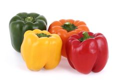 Isolated colorful bell peppers Royalty Free Stock Photos