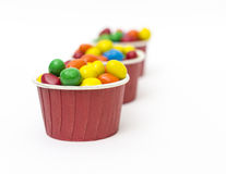 Isolated colorful candy in paper cup Royalty Free Stock Photography