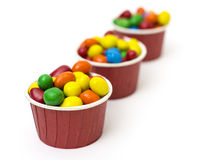 Isolated colorful candy in paper cup Royalty Free Stock Images