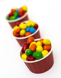 Isolated colorful candy in paper cup Royalty Free Stock Photos