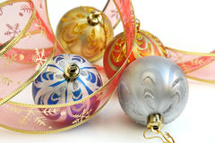 Isolated colorful Christmas baubles and ribbon Royalty Free Stock Images