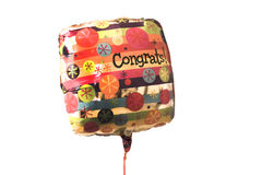 An Isolated Colorful congratulations balloon on white background. A colorful balloon with congratulations written on it isolated on a white background stock image