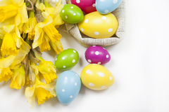 Isolated colorful Easter eggs and flowers Stock Image
