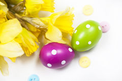 Isolated colorful Easter eggs and flowers Royalty Free Stock Image