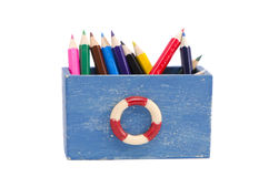 Isolated colorful pencils in the wooden box Royalty Free Stock Photography