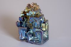 Colorful synthetically synthesized bismuth crystal. As a representation of the chemical element in the periodic table of elements stock photo