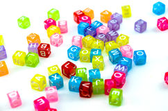 Isolated colourful small cubes scattered on white background. Stock Photos