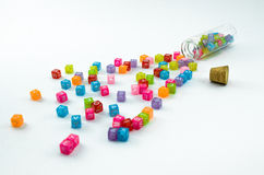 Isolated colourful small cubes scattered on white background. Stock Image
