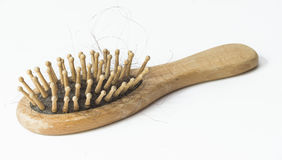 Isolated comb. Hair tangled comb on white board Royalty Free Stock Image