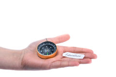 Isolated compass in hand. On a white background Royalty Free Stock Images
