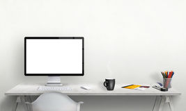 Isolated computer display for mockup in office interior. Stock Photos