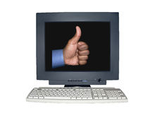 Isolated computer monitor with thumbs up scene concept. Computer monitor isolated over white by clipping path showing a thumbs up scene concept on the screen royalty free stock photography