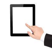 Isolated computer tablet and hand points to the screen Royalty Free Stock Photography