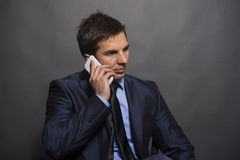 Isolated concerned businessman talking on the phone Royalty Free Stock Photography