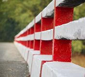 Isolated concrete protection wall of a bridge. A traditional concrete protection wall of a bridge isolated unique photo stock photo