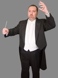 Isolated Conductor: Front On. Conductor isolated against a gray background Stock Photos