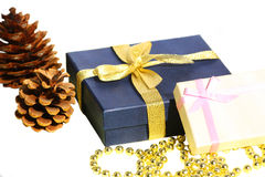Isolated cones, gift boxes and decoration beads Stock Photography