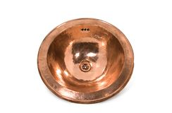 Copper round sink on white background. Isolated orange sink in retro style. Isolated copper sink in retro style. Antique sink for home on white background stock photos