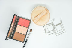 Isolated cosmetics, eye shadow brush and powder and with earrings. For beauty royalty free stock photography