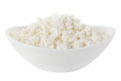 Isolated cottage cheese in a white bowl. Cottage cheese in a bowl isolated on a white background - with clipping path Royalty Free Stock Photo