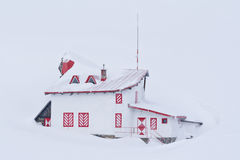 Isolated cottage surrounded by snow Stock Image
