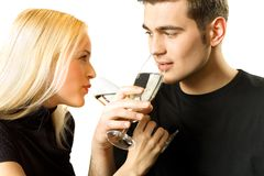 Isolated couple toasting. Isolated young couple toasting with champagne and looking at each other Stock Image