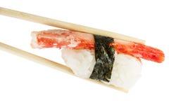 Isolated crab kani sushi nigiri. Isolated on white background in chopsticks carb kani sushi nigiri Stock Image